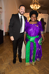 FRANK BEADLE DE PALOMO CEO of mothers2mothers and guest of honour NALUMU VIVIEN JULIET at a gala dinner to celebrate 15 Years of mothers2mothers hosted by Annie Lennox held at One Marylebone, 1 Marylebone Road, London NW1on 3rd November 2015.
