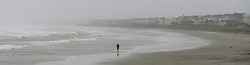 October 7, 2016 - Isle Of Palms, SC, USA - Robert Nicotra walks in the surf on the Isle of Palms on Friday, Oct. 7, 2016, as Hurricane Matthew is scheduled to skirt the coast of South Carolina later today/early Saturday morning. (Credit Image: © Jeff Siner/TNS via ZUMA Wire)