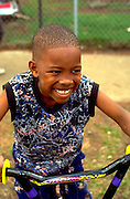 Boy age 9 enjoying summer vacation on bicycle.  St Paul  Minnesota USA