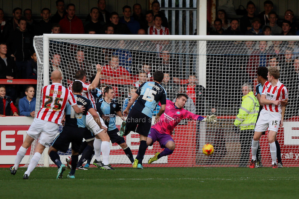Steve Elliott of Cheltenham scores his side's first goal to make the score 1-0.Skybet football league two match, Cheltenham Town  v Wycombe Wanderers at The Abbey Business Stadium, Whaddon Road in Cheltenham, Glos on Saturday 22nd November 2014.<br /> pic by Mark Hawkins, Andrew Orchard sports photography.