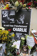 """Flowers and candles are placed in memorial for colleagues and friends. French journalists make a vigil in central Paris next to the Offices of Charlie Hebdo, marking one minute silence at midday, to mourn the death of their colleages. Ten staff including journalists, cartoonists and editors at Charlie Hebdo were killed the day before, when armed gunmen attacked the offices of Charlie Hebdo, killing twelve people including two policemen; four more are in critical condition. It is the deadliest terror attack in France for over fifty years. Charlie Hebdo is a satirical publication well known for its political cartoons. The newspaper had been threatened for making satirical images of the prophet Muhammad.<br /><br />As a solidarity action with the deaths at Charlie Hebdo many placards read """"Je suis Charlie"""" translating as """"I am Charlie (Hebdo)"""". Demonstrators hold aloft pens, brushes and crayons, in solidarity for their dead colleagues, symbolizing the profession of journalists and cartoonists who were killed. Many pens and candles have been placed in shrines throughout the city."""