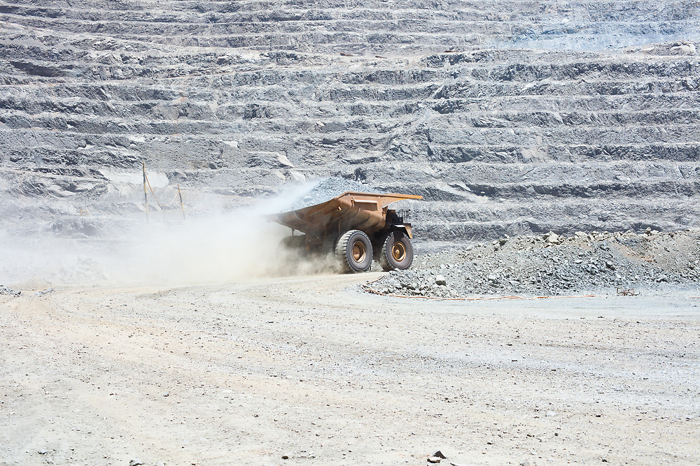Dust raised by a dump truck at a copper mine