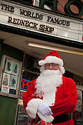 Santa Claus in front of the Redneck Shop December 5, 2009 in Laurens, SC during the 7th Annual White Unity Christmas Party held by the American Nazi Party & International Knights of the Ku Klux Klan.
