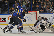 Colorado Avalanche goalie Semyon Varlamov (1) reaches for the puck as St. Louis Blues right wing Ryan Reaves (75) goes after it with his puck in third period action during a game between the Colorado Avalanche and the St. Louis Blues on Tuesday April 23, 2013 at the Scottrade Center in downtown St. Louis.  The Blues won, 3-1.