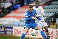 Coventry City forward Amadou Bakayoko can't get past Peterborough Utd defender Jason Naismith (2) during the EFL Sky Bet League 1 match between Peterborough United and Coventry City at London Road, Peterborough, England on 16 March 2019.