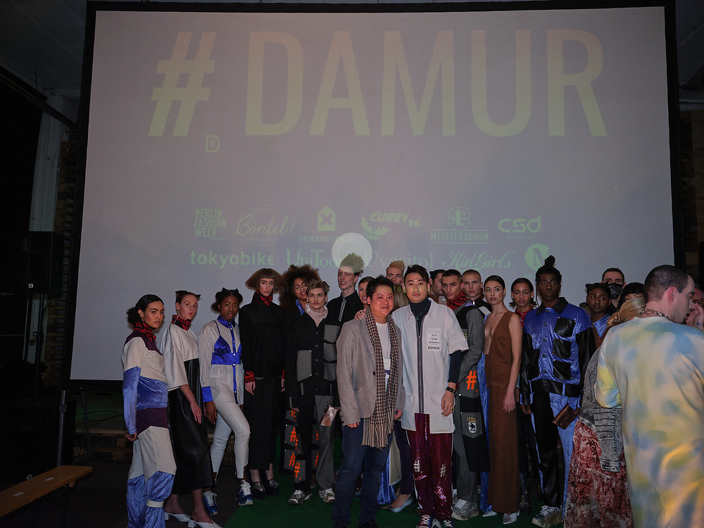 DEU, Deutschland, Berlin, 16.01.2020 /<br /> Shih-Shun Huang (in white jacket), Founder & Creative Director of the Berlin-based fashion label DAMUR, poses with friends, models and influencers after the presentation of his new collection at the Griessmuehle, Berlin. The fashion show was part of the Berlin Fashion Week, where the new Fall/ Winter 2020 collections were being presented.