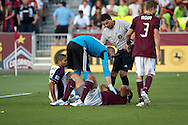 August 4, 2012: Colorado Rapids goalkeeper Matt Pickens (18) checks on his teammate defender Tyrone Marshall after a collision with Real Salt Lake forward Alvaro Saboru (15) in the first half at Dick's Sporting Goods Park in Denver, Colorado