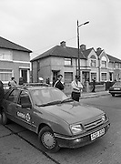 """John O'Grady Rescued By Gardai.   (R67)..1987..05.11.1987..11.05.1987..5th November 1987..After being kidnapped from his home in Cabinteely, Co Dublin, John O'Grady was finally rescued after twenty one days in captivity. he was located in a house inCarnlough Road, Cabra West, Dublin. During his ordeal Mr O""""Grady was mutilated by the kidnappers led by Dessie O'Hare to apply pressure on his family to pay the ransom sought. In an ensuing gun battle with the kidnappers a detective garda was shot and seriously wounded. In the chaos that followed the kidnappers escaped and were not all captured for a further three weeks after a massive manhunt...A garda car blocks off Carnlough Road after the gun battle to free John O'Grady."""
