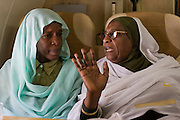 Ladies attending the first international Conference on Womens' Challenge in Darfur, sit in a chartered Russian Antonov aircraft during a flight to Al Fasher (also spelled, Al-Fashir) where women from remote parts of Sudan gathereed to discuss peace and political issues. The short flight saves them a hazardous five-day drive by road, known for extreme acts of violence by rebels and Janjaweed soldiers.