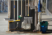 various cleaning brooms neatly hanging