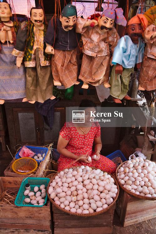 Woman selling garlic at local market, Bagan, Myanmar