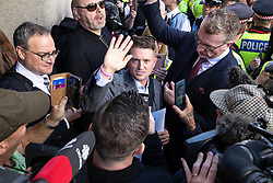 © Licensed to London News Pictures . 27/09/2018 . London , UK . TOMMY ROBINSON outside the court after a new date is set for his trial. EDL leader Tommy Robinson (real name Stephen Yaxley-Lennon ) outside the Old Bailey , as Robinson faces a retrial for Contempt of Court following his actions outside Leeds Crown Court in May 2018 . Robinson was already serving a suspended sentence for the same offence when convicted in May and served time in jail as a consequence , but the newer conviction was quashed by the Court of Appeal and a retrial ordered . Photo credit: Joel Goodman/LNP