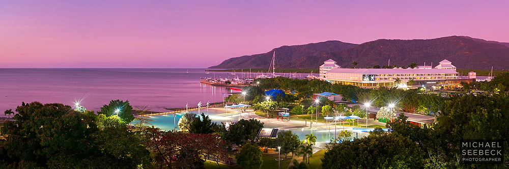 A panoramic photograph of sunset twilight over the Cairns Esplanade and Esplanade Pool.<br /> <br /> Code: HAQT0051<br /> <br /> Open Edition Print & Available as a Stock Image