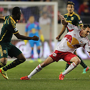 Eric Alexander, (right), New York Red Bulls, slips as he is challenged by Steve Zakuani, Portland Timbers, during the New York Red Bulls Vs Portland Timbers, Major League Soccer regular season match at Red Bull Arena, Harrison, New Jersey. USA. 24th May 2014. Photo Tim Clayton