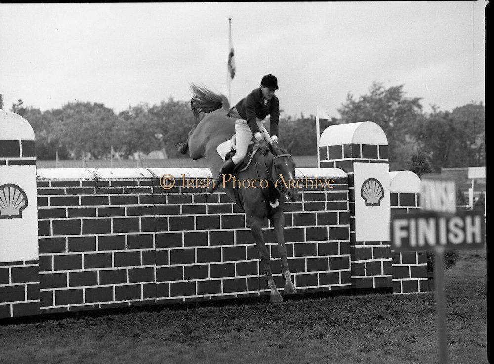 Shell Sponsored Events At The Dublin Horse Show.(R39).1986..07.08.1986..08.07.1986..7th August 1986..At the Horse Show Shell sponsored both the Speed and Power competition and The Puissance..The Speed and Power event was won by Hap Hanson riding 'Gambrinus'. The Puissance was shared by Capt John Ledingham (Irl) on 'Kilcoltrim' and Nick Skelton (GB) on 'Raffles Apollo' who both cleared the high wall at 7feet.