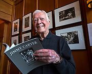 President Jimmy Carter at an exhibition of photojournalist Ken Hawkins'platinum photographs documenting his political and personal life from 1970 to 2010.