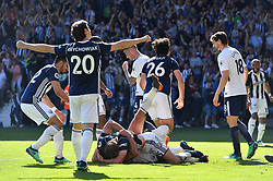 West Bromwich Albion's Jake Livermore (centre bottom) celebrates scoring his side's first goal of the game with Craig Dawson (centre top) during the Premier League match at The Hawthorns, West Bromwich.