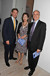Left to right, MARTIN MORGAN, FELICITY SWAN and DOUG WILLS at a fundraising party hosted by the Kensington and Chelsea Foundation at The Saatchi Gallery, Kings Road, London on 27th September 2011.