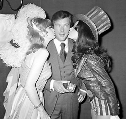 File photo dated 04/01/71 of Roger Moore being kissed from Miss UK and Miss USA. Sir Roger has died in Switzerland after a short battle with cancer, his family has announced.