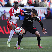 Lloyd Sam, (left), New York Red Bulls, is challenged by Davy Arnaud, D.C. United, during the New York Red Bulls Vs D.C. United, Major League Soccer regular season opening match at Red Bull Arena, Harrison, New Jersey. USA. 22nd March 2015. Photo Tim Clayton