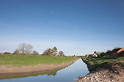 Looking upstream on the River Parrett, from the conflagration between the Tone and Parrett. Part of the Somerset Levels near Burrow Mump.