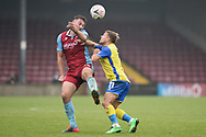 Tyler Cordner (26) of Scunthorpe United Jamie Ward of Solihull Moors battles for possession during the The FA Cup match between Scunthorpe United and Solihull Moors at the Sands Venue Stadium, Scunthorpe, England on 8 November 2020.