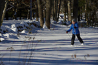 Jessica Laman cross country skiing in the New England woods.