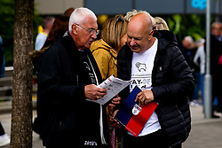 Derby County fans arrive at Wembley for the Sky Bet Playoff Final against Aston Villa reading the programme - Mandatory by-line: Robbie Stephenson/JMP - 27/05/2019 - FOOTBALL - Wembley Stadium - London, England - Aston Villa v Derby County - Sky Bet Championship Play-off Final