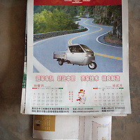 A calendar, given to Wei Xinyuan as a present by the company that sold him his tuk-tuk hangs on the wall of his living room. This vehicle was going to be used to haul the heavy bags of rice and corn harvested from the fields. It was going to be used by their youngest son so he could make a little cash by driving people to the market. <br /> <br /> Late one night, the tuk-tuk was stolen. The thieves barricaded the door from the outside and drove away as the family, hearing the sound of the engine, was helpless to stop them. Soon after, Wei and Lu's youngest son, seeing no opportunity for cash income in the village, joined his brother in the city.