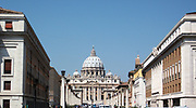 Distant photo of St. Peter's Basilica in the Vatican City, Italy. The church is the most renowned work of Renaissance architecture, and was designed by Donato Bramante, Michelangelo, Carlo Maderno and Gian Lorenzo Bernini. The original basilica is from 4th century AD, but the current design was completed in 1626.