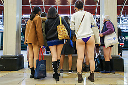 "© Licensed to London News Pictures. 13/01/2019. London, UK. People take part in 10th anniversary of 'No Trousers Tube Ride' event on the London Underground.<br /> The ""No Pants Subway Ride"" is an annual event staged by Improve Everywhere every January in New York City. The mission started as a small prank with seven guys and has grown into an international celebration of silliness, with dozens of cities including London around the world participating each year. Photo credit: Dinendra Haria/LNP"