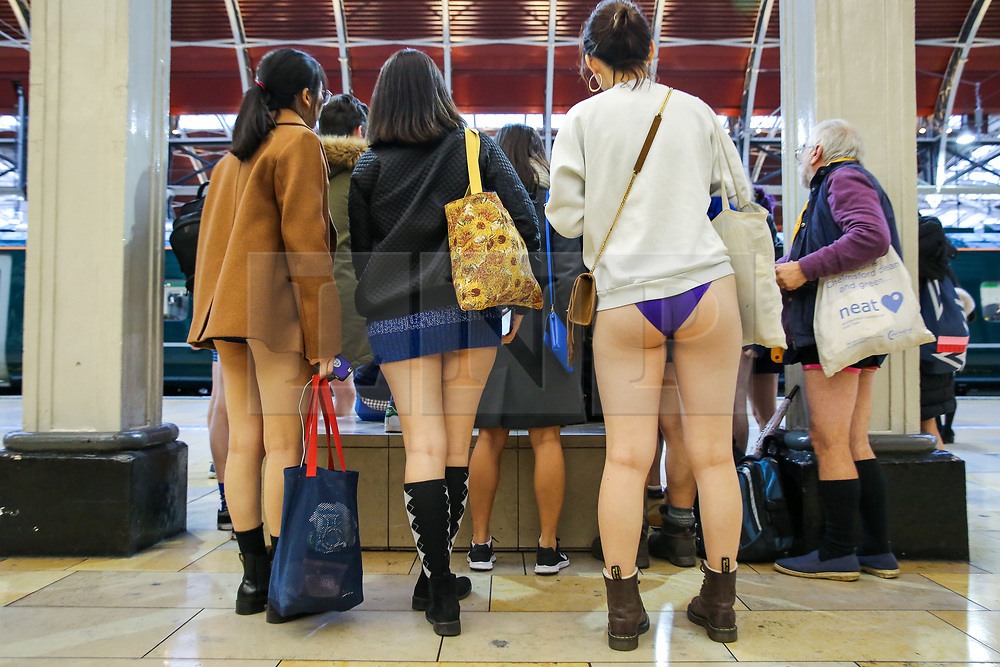 """© Licensed to London News Pictures. 13/01/2019. London, UK. People take part in 10th anniversary of 'No Trousers Tube Ride' event on the London Underground.<br /> The """"No Pants Subway Ride"""" is an annual event staged by Improve Everywhere every January in New York City. The mission started as a small prank with seven guys and has grown into an international celebration of silliness, with dozens of cities including London around the world participating each year. Photo credit: Dinendra Haria/LNP"""