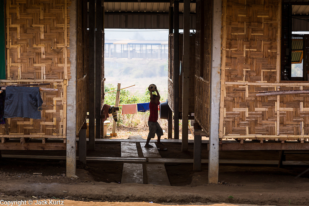 03 MARCH 2104 - MAE KASA, TAK, THAILAND: A boys plays in the housing area at the Sanatorium Center for Border Communities in Mae Kasa, about 30 minutes north of Mae Sot, Thailand. The Sanatorium provides treatment and housing for people with tuberculosis in an isolated setting for about 68 patients, all Burmese. The clinic is operated by the Shoklo Malaria Research Unit and works with several other NGOs that assist Burmese people in Thailand. Reforms in Myanmar have alllowed NGOs to operate in Myanmar, as a result many NGOs are shifting resources to operations in Myanmar, leaving Burmese migrants and refugees in Thailand vulnerable. Funding cuts could jeopardize programs at the clinic. TB is a serious health challenge in Burma, which has one of the highest rates of TB in the world. The TB rate in Thailand is ¼ to ⅕ the rate in Burma.        PHOTO BY JACK KURTZ
