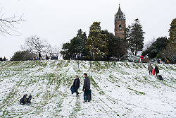 © Licensed to London News Pictures; 24/01/2021; Bristol, UK. People exercise and enjoy some snow at Brandon Hill by sledging and building snowmen as England is under a third national lockdown since the start of the Covid-19 coronavirus pandemic after a new strain of a more infectious Covid virus has spread through the country. Photo credit: Simon Chapman/LNP.