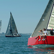 August 11, 2007 -- FALMOUTH, Maine. Richard Hallett's Family Wagon, right, of Falmouth, watches as Revolution 2, owned by Ed Rogers, passes ahead of him near the start of the Monhegan Race.   Photo by Roger S. Duncan.  ..