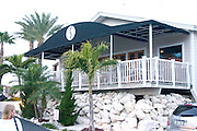 Fine dining at Salt Rock Grill overlooking The Narrows of the Gulf Intercoastal Waterway.  Indian Shores Tampa Bay Area Florida USA