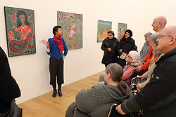 Visually impaired art class from Mysight charity with Liaison Officer describing Haitian exhibition at Nottingham Contemporary art gallery.