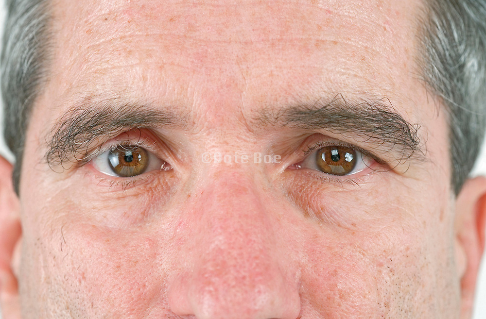 close up of a middle aged man's face looking straight at you