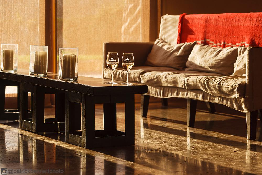 Two glasses of white wine on a table inside the Bodega Catena Zapata in Lujan de Cujo, Mendoza, Argentina.