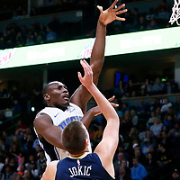 11 November 2017: Orlando Magic center Bismack Biyombo (11) goes for the baby hook over Denver Nuggets center Nikola Jokic (15) during the Denver Nuggets 125-107 victory over the Orlando Magic, at the Pepsi Center, Denver, Colorado, USA.