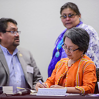 United Nation special rapporteur Victoria Tauli-Corpuz takes notes during a special meeting at the Navajo Division of Transportation Building in Tse Bonito Friday.
