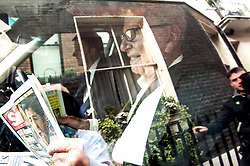 Image ©Licensed to i-Images Picture Agency. 26/06/2014. <br /> <br /> Rupert Murdoch leaves his home in central London, UK, reading a copy of the morning papers.<br /> <br /> Picture by Ben Stevens / i-Images