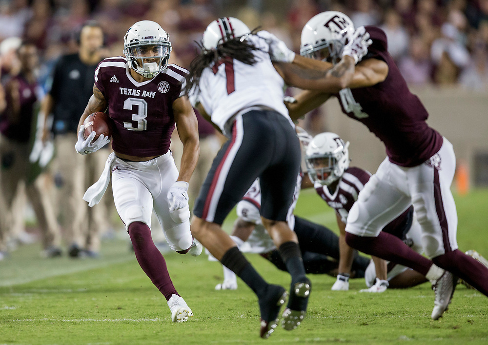 Texas A&M wide receiver Christian Kirk (3) rush for yards after a catch during the third quarter of an NCAA college football game against South Carolina Saturday, Sept. 30, 2017, in College Station, Texas. (AP Photo/Sam Craft)