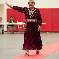 Lois Becentti, of Coyote Canyon, waves to an adoring audience as she walks the red carpet elder fashion show. The event was held in the Wellness Center in Crownpoint on May 07.