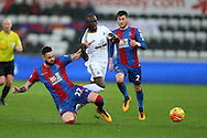 Modou Barrow of Swansea city © is tackled by Damien Delaney of Crystal Palace. Barclays Premier league match, Swansea city v Crystal Palace at the Liberty Stadium in Swansea, South Wales on Saturday 6th February 2016.<br /> pic by Andrew Orchard, Andrew Orchard sports photography.