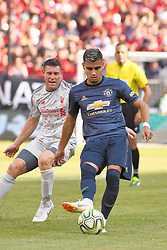 July 28, 2018 - Ann Arbor, MI, U.S. - ANN ARBOR, MI - JULY 28: Manchester United Midfielder Andreas Pereira (15) sends the ball to his defense while pressured by Liverpool Midfielder James Milner (7) in the ICC soccer match between Manchester United FC and Liverpool FC on July 28, 2018 at Michigan Stadium in Ann Arbor, MI. (Photo by Allan Dranberg/Icon Sportswire) (Credit Image: © Allan Dranberg/Icon SMI via ZUMA Press)