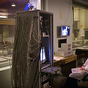 A technician sitting in a control room monitors a research reactor, containing highly-enriched uranium, at the Moscow Civic Engineering Institute.