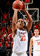 CHARLOTTESVILLE, VA- NOVEMBER 26:  Malcolm Brogdon #22 of the Virginia Cavaliers handles the ball during the game on November 26, 2011 at the John Paul Jones Arena in Charlottesville, Virginia. Virginia defeated Green Bay 68-42. (Photo by Andrew Shurtleff/Getty Images) *** Local Caption *** Malcolm Brogdon