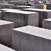 Group of people talking at Berlin's Holocaust Memorial