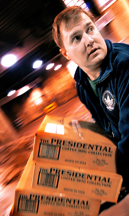 Brian Harlin is the owner of Ellicott City based GOP Shoppe, the exclusive Master Vender to the 2005 Presidential Inauguration. He, and his crew of six, are running around the Washington Convention Center Wednesday January 19th, 2004 unloading boxes of merchandise, all of which Harlin designed, slated for sale during the Inaugural Balls the following day. Harlin was the Master Vender for the 2001 Inauguration, as well...